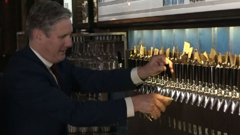 Still of Labour leader Sir Keir Starmer pouring a pint on a visit to a brewery in east London