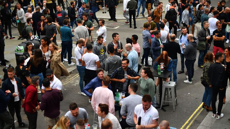 Drinkers in Soho, London, as coronavirus lockdown restrictions are eased across England