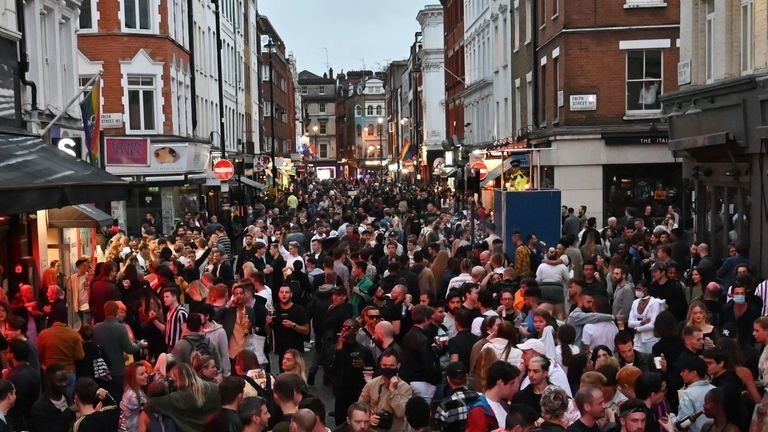 Revellers pack a street outside bars in the Soho area of London