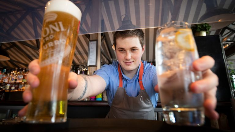 Barman Matthew Williams serves drinks at Scotts in South Queensferry