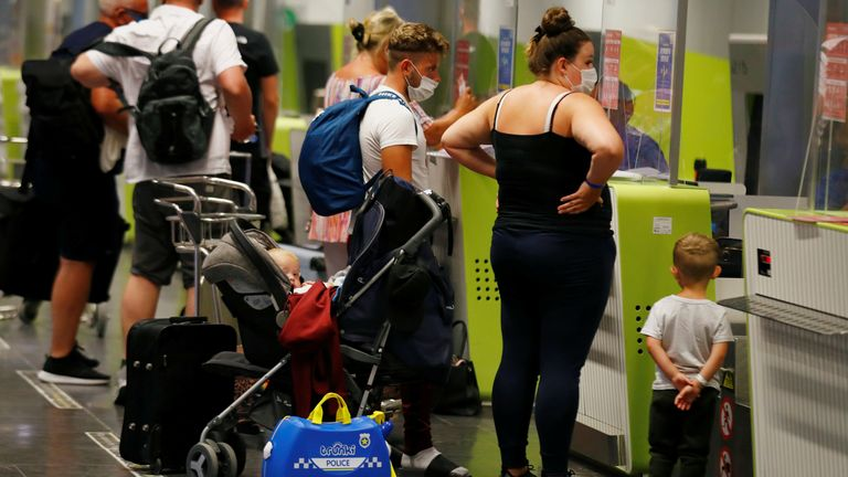 British tourists returning to UK check in their luggage at Gran Canaria Airport, Spain