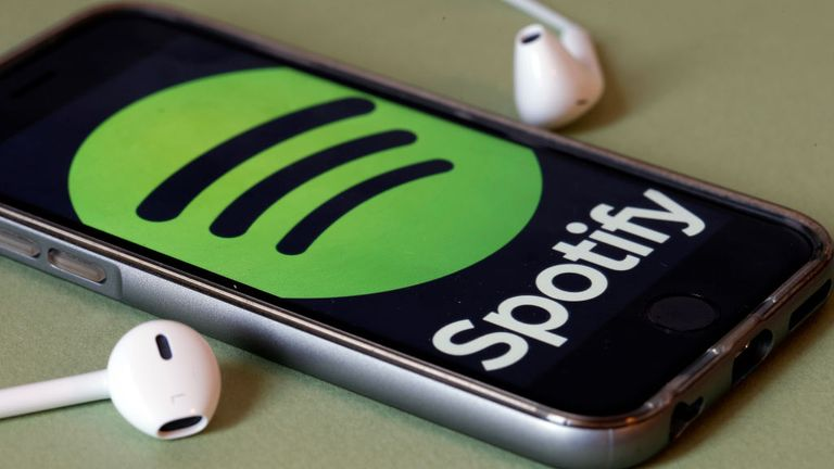 PARIS, FRANCE - JANUARY 06: In this photo illustration, the logo of the Swedish music streaming service Spotify is displayed on the screen of an iPhone on January 06, 2017 in Paris, France. Spotify announced, via a tweet published Thursday, that it now has 70 million paid subscribers. As a comparison, in September, Apple Music claimed 30 million subscribers and Deezer had fewer than 10 million subscribers. Spotify, the world's largest streaming music company, is expected to be listed on the Wall