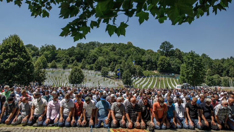 Bosnian Muslims pray during the mass funeral at the memorial and cemetery in Potocari near Srebrenica