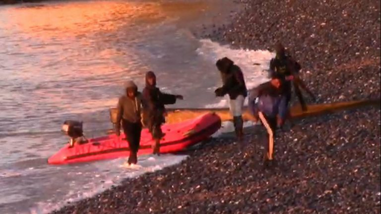 In the early hours of the morning migrants land their boat onto the pebbles of St Margaret's bay in Kent.