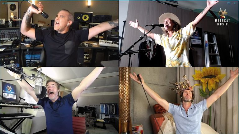 Gary Barlow, Mark Owen and Howard Donald of 'Take That' featuring Robbie Williams sing in an online performance during the UK lockdown