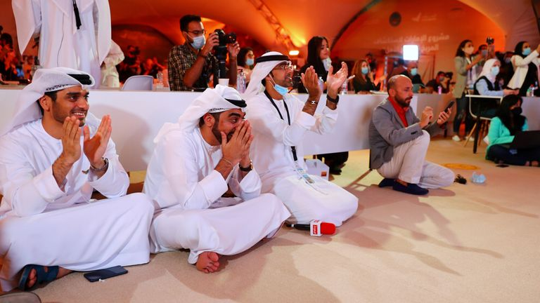 People react as they watch a big screen displaying the launch of the Hope Probe from Tanegashima Island in Japan, at the Mohammed bin Rashid Space Centre in Dubai, United Arab Emirates July 20, 2020