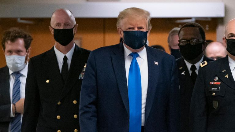 Trump dons masks in visit to a military medical facility