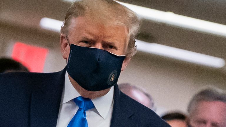 US President Donald Trump wears a mask as he visits Walter Reed National Military Medical Center in Bethesda, Maryland' on July 11, 2020