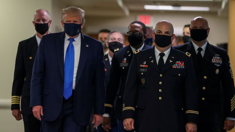 President Donald Trump wears a mask while visiting Walter Reed National Military Medical Center in Bethesda