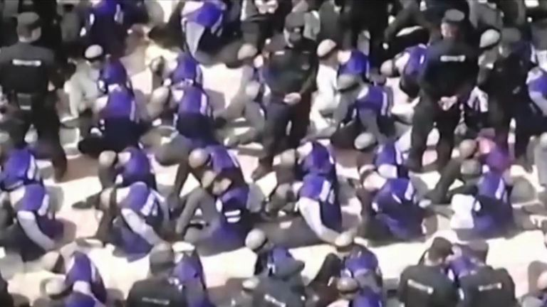 Video has emerged purportedly showing Uighur prisoners bound and blindfolded at a train station in China