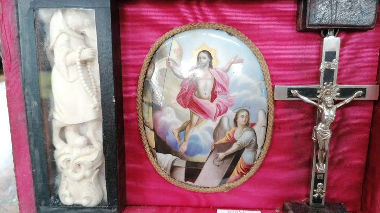 A robed wolf, crucifix and picture of the resurrection of Christ are among the items in the box