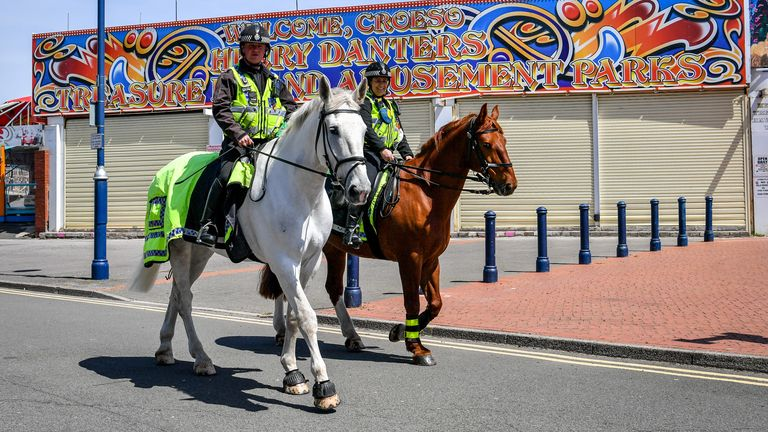 Mounted police patrol Barry Island, Wales, where the stay at home message is still in force and only essential travel is allowed