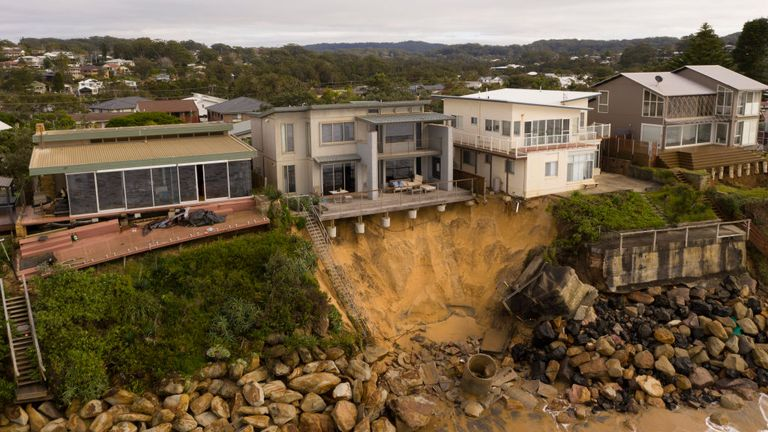 The foundations of homes in Wamberal were exposed as the waves battered the cliff