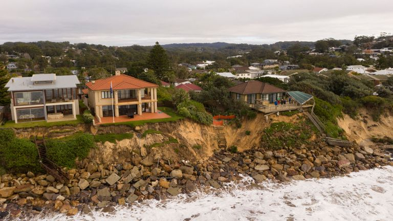 Beach front homes were evacuated as they were at risk of collapsing into the sea