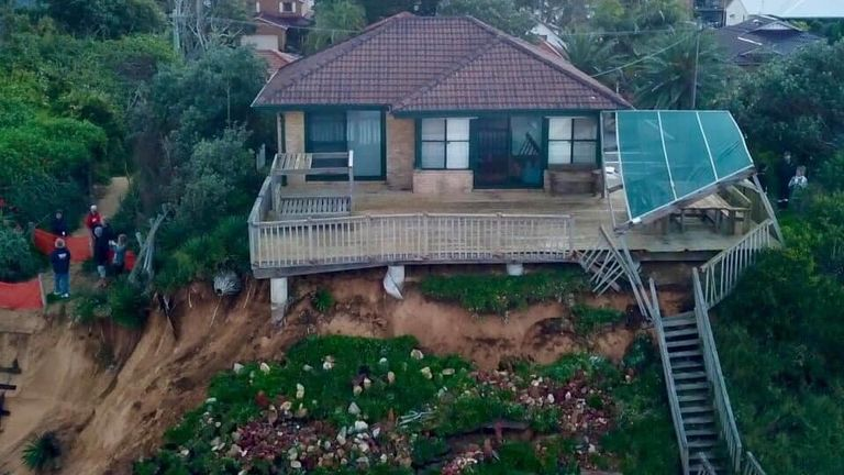 Firefighters were called to homes in Ocean View Drive, Wamberal, as they risked collapse. Pic: Terrigal Fire Station/Anthony Parry
