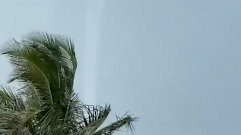 Weather warnings  were put out ahead of storms in Palm Beach, Florida where waterspouts were seen to hit land.