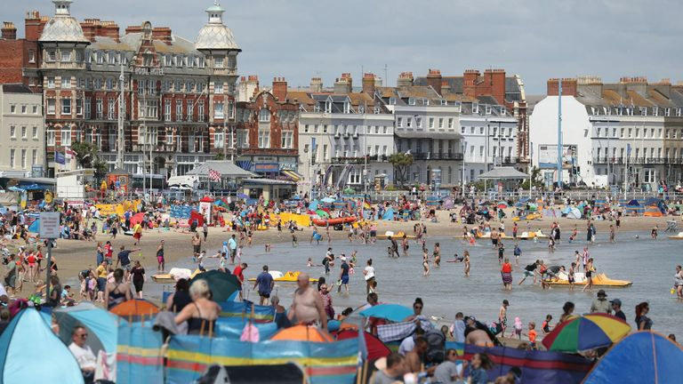 People playing in the sea on Weymouth beach in Dorset on Wednesday