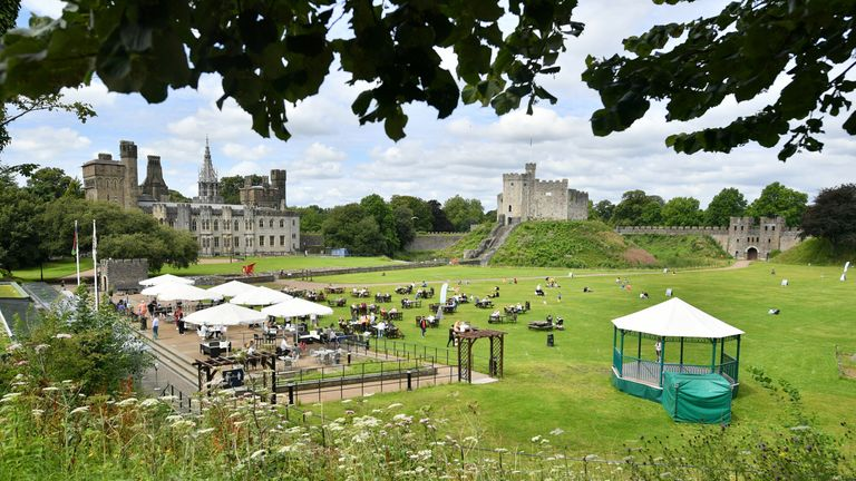People enjoy the warm weather at Cardiff Castle on Wednesday