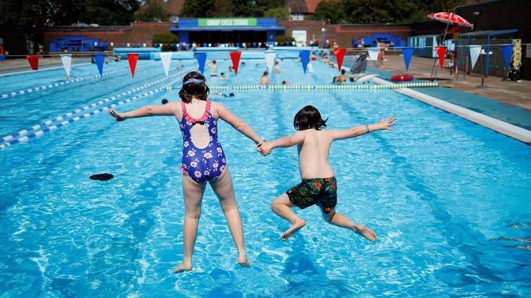Not near a beach? Children jump into the pool at Charlton Lido in southeast London