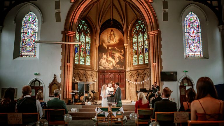 The wedding of Tom Hall and Heather McLaren, at St George's Church, Leeds, as weddings are once again permitted to take place in England