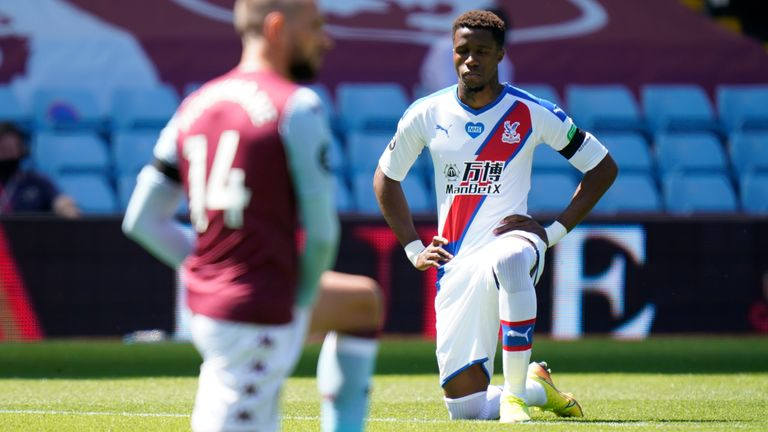Crystal Palace's Wilfried Zaha takes a knee in in honour of Black Lives Matter movement during the Premier League match at Villa Park, Birmingham