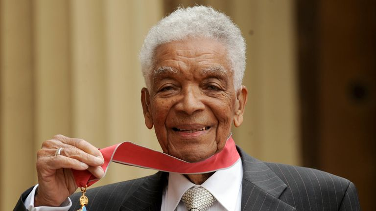 Earl Cameron outside Buckingham Palace with his CBE in 2009