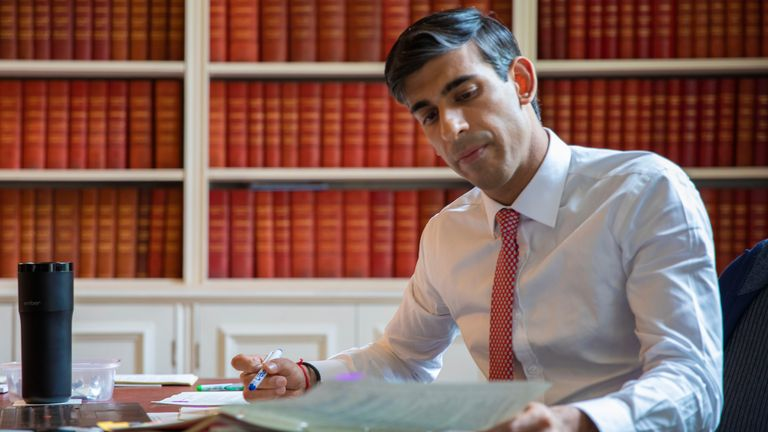 Chancellor Rishi Sunak prepares the 'mini budget' he will present to the commons on Wednesday