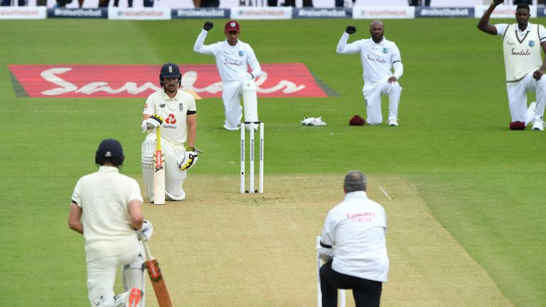 England and West Indies players and the umpires took a knee in support of the Black Lives Matter before play started