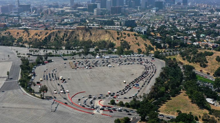 Cars are seen lining up for a drive-in coronavirus testing centre in Los Angeles where lockdown has been reinstated