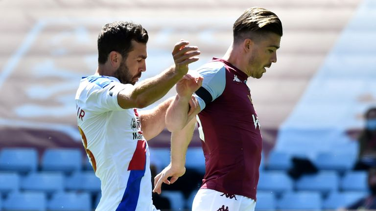 Aston Villa's Jack Grealish battles for possession with Crystal Palace's James McArthur