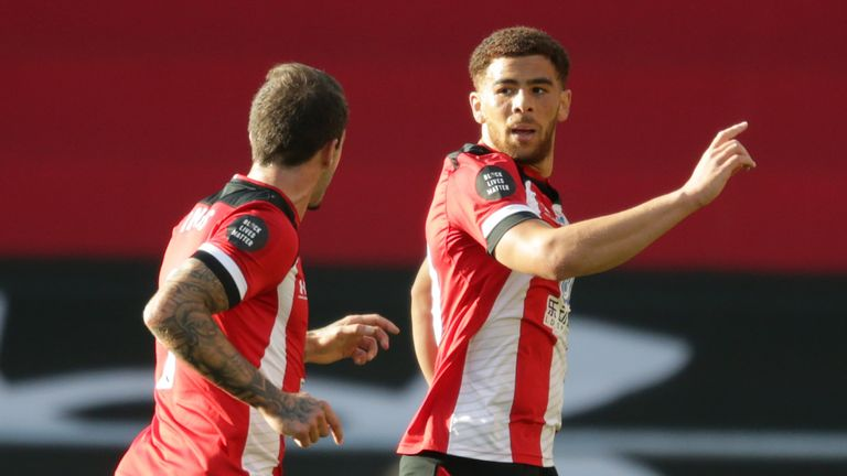 Che Adams celebrates his speculative opener at St Mary's