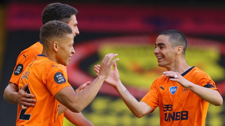 Dwight Gayle celebrates his goal against Watford with Newcastle team-mate Miguel Almiron