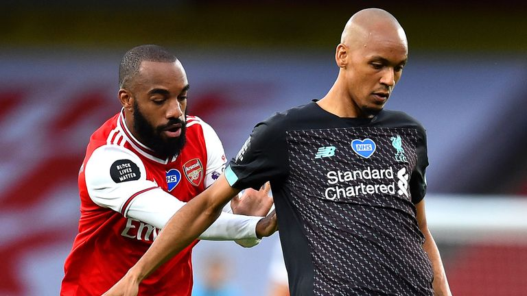 Fabinho is challenged by Arsenal forward Alexandre Lacazette