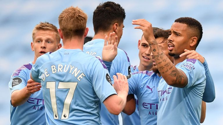 MANCHESTER, ENGLAND - JULY 08: Gabriel Jesus of Manchester City celebrates with his team after scoring his teams first goal during the Premier League match between Manchester City and Newcastle United at Etihad Stadium on July 08, 2020 in Manchester, England