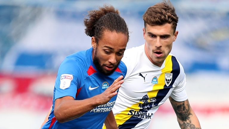 Portsmouth's Marcus Harness and Oxford United's Josh Ruffels battle for the ball