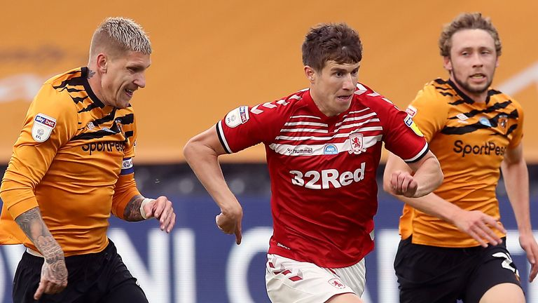 Middlesbrough's Paddy McNair (centre) and Hull City's Jordy de Wijs (left)