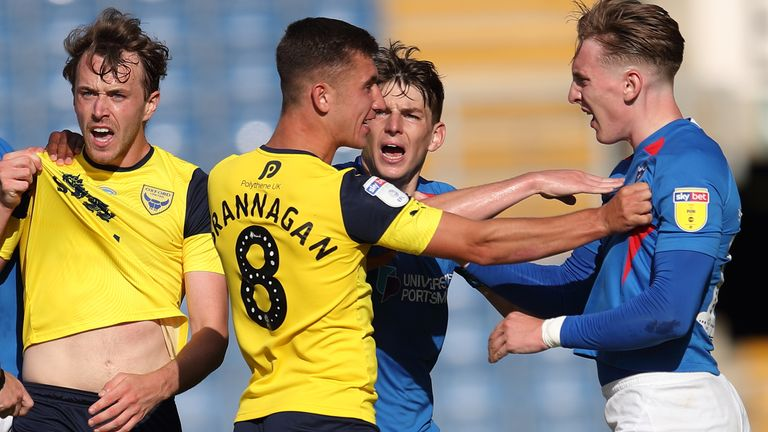 Oxford and Portsmouth players clash during their play-off semi-finals