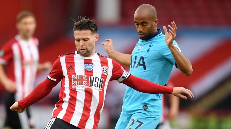 Lucas Moura vies with Oliver Norwood