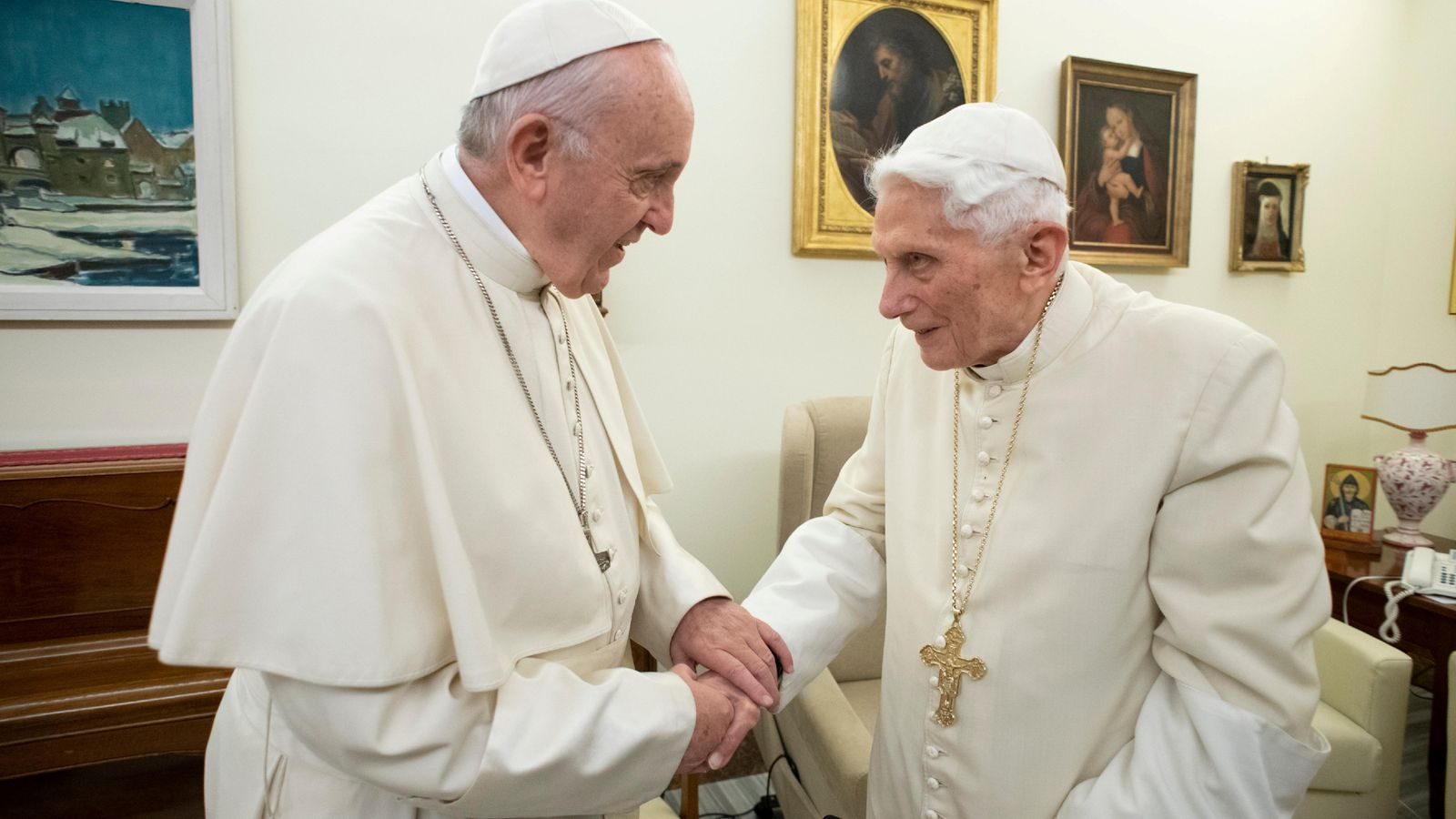 Benedict, right, was succeeded by Pope Francis, left
