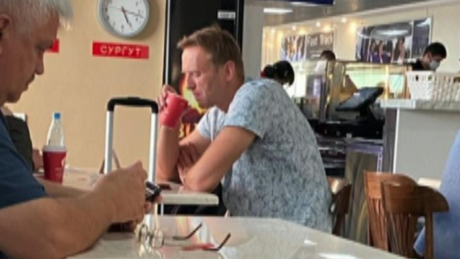 Alexei Navalny is seen at a Siberian airport before boarding the plane where he was taken ill. Pic: @djpavlin