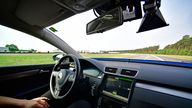 HANOVER, GERMANY - JUNE 20: A driver presents a Cruising Chauffeur, a hands free self-driving system designed for motorways during a media event by Continental to showcase new automotive technologies on June 20, 2017 in Hannover, Germany. The company presented new clean diesel technology, cable-less and other advances in electric car charging, smartphone technology for rental cars, driverless car advances and robotic taxi services. (Photo by Alexander Koerner/Getty Images)