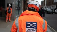 Members of the construction team stand outside the entrance hall of Farringdon Crossrail station