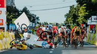 Fabio Jakobsen's bicycle flies through the air as he collides with Dylan Groenewegen (L)