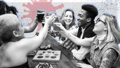 Young people enjoy a drink in a pub