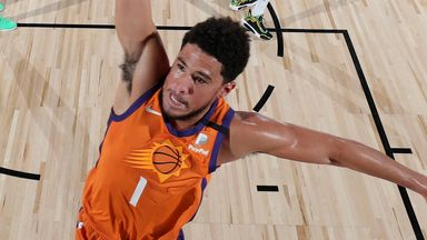 Booker fires for 27 in Suns win