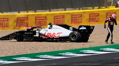 Magnussen off after contact with Albon!