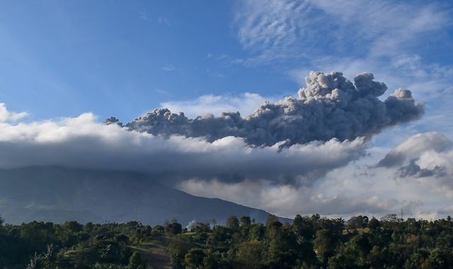 Mount Sinabung volcano erupts, sending column of ash 5,000m into the sky