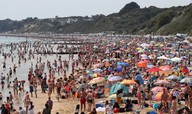 Coronavirus: Public urged to avoid packed beaches again as UK heatwave continues