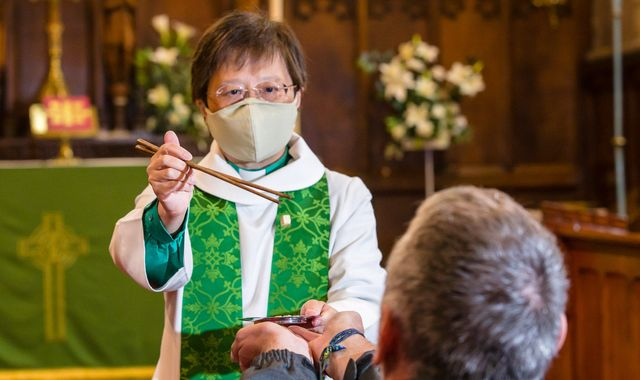 Coronavirus: Vicar uses chopsticks to serve bread in Holy Communion safety measure