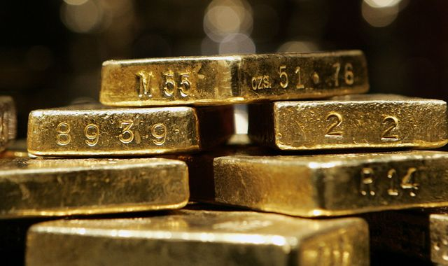 Gold strikes record high after topping $2,000 for first time